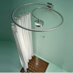 Matteo Thun's Pluviae : The shower head at the end of the shower curtain rail.......simple and ingenious.