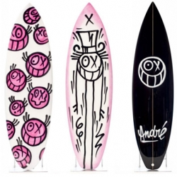 Parisian artist André has hand painted 12 Quiksilver surfboards. They look great!
