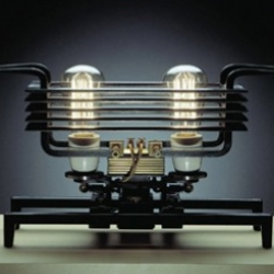 Berlin designer Frank Buchwald's Machine Lights series is comprised of 12 steampunk lamp designs, complete with visible coils, filaments, cables, and flexible brass tubes.