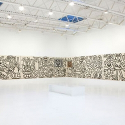 Keith Haring's 70-foot long mural, originally created in 1985, is now in display at Deitch Gallery in New York City. Today, it is still very impressive!