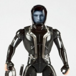 Disney has released images of the merchandise for the upcoming TRON Legacy movie, including an action figure with amazing Impulse Projection Technology that lights up life-like images of the character's face.