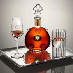 Louis XIII Cognac and Christophe Pilet ~ the latest luxury design collaboration: a crystal glass, a silver illuminated serving platter, a crystal candleholder and a display case.