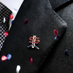 Men's Vogue commissioned renowned graphic designer Michael Bierut to design this patriotic lapel pin. All proceeds benefit Dog Tags.