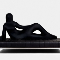 The Divina sofa by Fabio Novembre for Driade  incorporates the silhouette of a reclining woman on the actual piece. Tufted black leather over a stainless steel frame and stuffed with polyurethane foam.