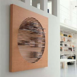 This wood CD wall rack by Porada serves as wall art as well as a functional way to store your cds!