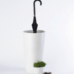 I love this Umbrella Pot by Kyouei Design. Made of ceramic it uses the water run off from the umbrella to water the plant!