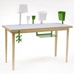 Amazingly clever! My Table designed by Tiina Hakala from Finland allows the user to create his/her own workspace. The re-configurable sheet metal parts  slide in between two table tops.