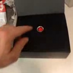Samsung i900 Omnia 'viral' unboxing video.  Not the best actor or effects, but funny play on the unboxing experience, featuring a big red button.