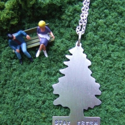 Melanie Favreau makes lots of clever jewelry and this sterling silver pine car air freshener is one of her latest pendants. I love it!