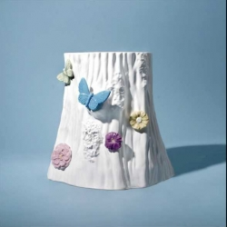 We'll all seen ceramic stump stools but this is the first with colored hand-appliqued butterflies and flowers on it! From DFC.  $580 USD