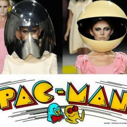 Giles Deacon's runway show for his 2009 Spring Summer Collection:  Models wore large metal helmets making them appear as characters from the 1980s pac man video game...just beautifully dressed, of course. Wocka wocka wocka