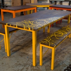 Seoane has some beautiful tables ~ love the wood with a splash of color