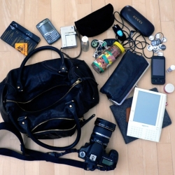 What's in my purse? A lot of tech... and it gets heavy! In a discussion about tiny laptops and how tiny your ideal one would be, Marcia convinced me to expose what's really in there!