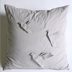 Interesting concept ~ fabric origami as pillow decorations... Cotton linen feather-filled Origami Pigeon Pillow, with tonal cotton origami-style birds folded and affixed to the front.