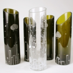 Revive is a series of glass vases as second life of wine bottles. Die cutting and sandblasting adds different look to the bottles. The graphic on each vase represents five major air pollutants, PM10, SO2, NO2, CO, O3 and the cause of those pollutants. Most of the cause are from combustion. One can reduce certain amount of air pollutant by reusing glasses bottles and reducing the production process of making glasses.  To view more images: http://www.coroflot.com/public/individual_set.asp?from_url=true&set_id=288493&individual_id=190163