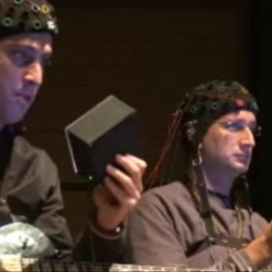 "World premiere of brain orchestra. Led by an ""emotional conductor"" and a traditional one, music and video change in time with the performers' brain waves and heart rate."