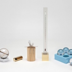 Aussie design duo Daniel To and Emma Aiston launch their first desk accessory range called 'D.E.' which includes a rubber band ball paperweight, a magnetic paperclip tower, thermometer and stationery container.