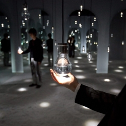 Toshiba lighting systems at milan design week 09 - WOW - featuring lights surrounded by arches of mirrors. LED lights embedded in the objects will glow brighter as people approach, and pulsate as if alive.