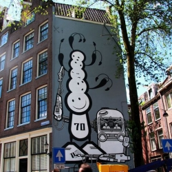 The London Police recently completed the wonderful mural above in the heart of the historic Jordaan district in Amsterdam. Despite getting written permission from the owner of the building, the City Council has threatened to remove it.
