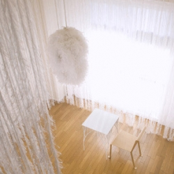 """Japanese designer Nosigner has completed his own office interior, which is veiled by a feather-like curtain inspired by a traditional hagoromo (""""feather robe"""") kimono."""