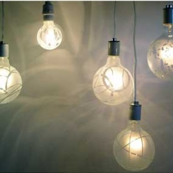 """Designer Melissa Borell's etched glass Shadow Bulbs are 5"""" in diameter and cost $90.00 a piece. May seem pricey, but think of what you save on not getting a shade! They cast amazing shadows."""