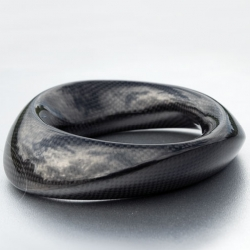 Marketa Richterova's Carbon Collection jewelry makes carbon fiber look more like a robo-snake like organic structure...