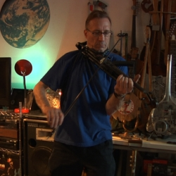 Ken Butler turns axes, toy guns, and other objects into playable violins.