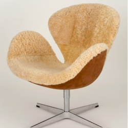 I love this Limited Edition classic Arne Jacobsen Swan Chair upholstered in real shearling and Mocha suede.