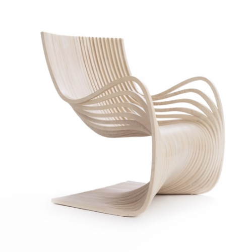 The Piegatto Pipo Chair is conceived as a wooden surface that integrates armchairs and seat from the same material.