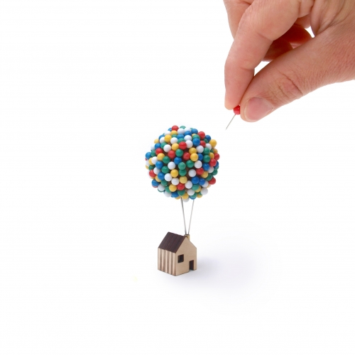 Balloon Pin House, great place to store map or noticeboard pins. Miniature balloon cluster of 300 individual pins float above a tiny rooftop.