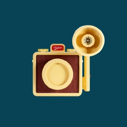 Pinhole. A beautiful plastic pinhole camera, with leather details. Featuring a mountable flash and a rabbit fur strap.