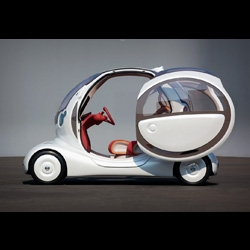 This is Pivo, it was designed by Creative Box*, they design cars, they designed Pivo for Nissan, Pivo is a compact car that pivots on a central axis while turning and parked. (*Site is Flash based.)