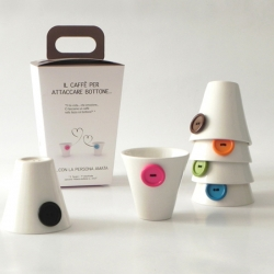 "About coffee frim playdesign. The coffee break is an italian opportunity to ""attaccare bottone"". Product design of white ceramic coffee cups with 6 different colors buttons."