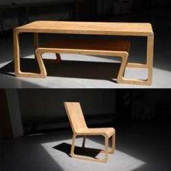 A unique table designed by Simon Goetz. A table that looks layered from the legs of the table connect to a small table beneath.