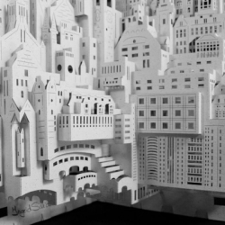 "Dutch artist Ingrid Siliakus designs and builds ""paper architecture,"" creating meticulous metropolises that layer paper silhouettes of buildings with their own cut-out negatives and the delicate shadows cast by their fragile facades."