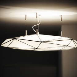 Potato, a pendant lamp, hand-made of white glass pieces using the traditional Tiffany technique. Limited edition product by design group PL09, manufactured near Warsaw, Poland.