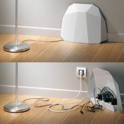 The Powerblock is a modern sculptural hidden powerstrip or recharging station. It kinda looks like a mouse made a Geodesic dome for his entrance.. Designed by Jérôme LOPÉ & Johann AUMAITRE