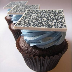 QR Code Cupcakes - scan them with your iPhone and you go straight to a pre-set website.  Edible genius!