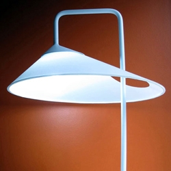 Ran Lerner's asymmetrical Oval Lamp with a continuous surface and the stem provides a visual counter balance, emission of upward lighting.
