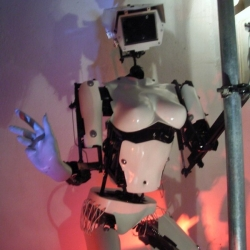 Fully animated robot pole dancers, and robot DJ. They are made from raw materials found in various scrap yards and controlled, via a PC, using a DMX lighting programme.