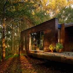 Wooden small house beyond the trees. Architects: Rosales + Crecentes, from Galicia
