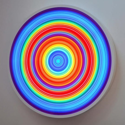 Created by UK artists Rob and Nick Carter, the RN754 is a unique color changing light box with 15 concentric circles of neon and a fully programmable color changing sequence.