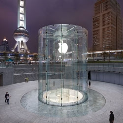 A new Apple store just opened in Shanghai, Apple's 2nd store in China. Modeled after the 5th Ave. store in NY, it features a large glass cylinder. View more photos by Roy Zipstein
