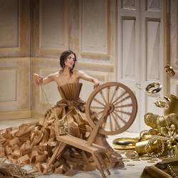 This is a shoot based upon the Brothers Grimm tale of Rumpelstiltskin. The dress is made from baking paper and the wheel cardboard,  the room and props are all designed, created and painted by hand.