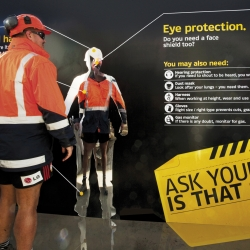 Studio Alexander's pop-up site safety installations for Fletcher Construction. Reality portraits, lightboxes and a mirrored surface combined to remind workers to check themselves for safety gear as they entered the work site.