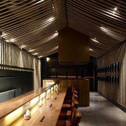 Amazing design at a Sake bar in Melbourne. The interior, mostly 'bound' by ropes,  demonstrates  use of  ordinary recyclable material -the rope idea originated from the classic design of sake bottles,  traditionally secured with ropes.