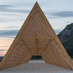 Like a viking longhouse, Rintala Eggertsson Architects create a sprawling, skeletal iteration of the fish rack, a gritty symbol of the spirit of Norway, built as part of the region's SALT celebration.