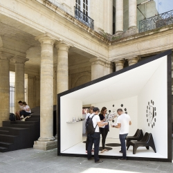 NAS architecture's SCAPE pavilion for festival of lively architecture - The main pavilion of the 10th édition of the Festival begins from the ground, unfolding in a multitude of random steps around the old majestic columns of the courtyard.