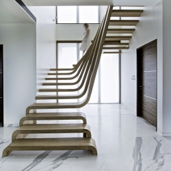 The centerpiece of the SDM apartment designed by Arquitectura en Movimiento Workshop is the staircase, a striking work of art in and of itself.