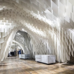 3Gatti uses 10,000-fiberglass shapes to create the undulating ceiling at SND Concept Store.